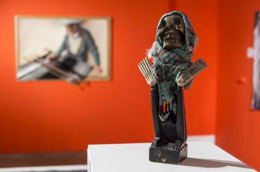 Le Bruja de Rebozo or 'The Rebozo Witch' by Humberto Batista which illustrates the ways in which the rebozo is used to hide feelings and moods - especially mourning death.
