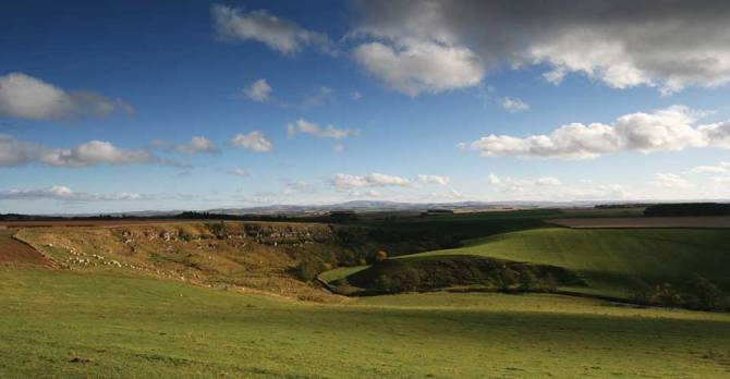 The south-easterly view looks to the rounded summits of the Cheviots in the Northumberland National Park.