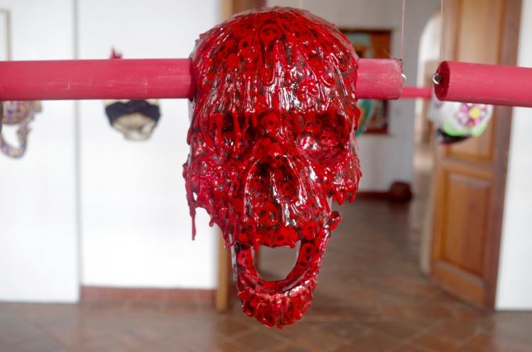 The Tzompantli exhibition at Colegio Jesuita, Patzcuaro, 43 papier-mache skulls decorated by 43 different artists to represent the Ayotzinapa students killed in 2014.jpg