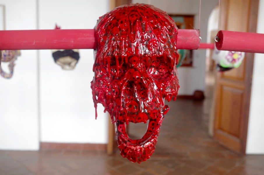The Tzompantli exhibition at Colegio Jesuita, Patzcuaro, 43 papier-mache skulls decorated by 43 different artists to represent the Ayotzinapa students killed in 2014.jpg